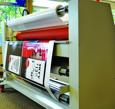 With roll-to-roll lamination, graphics are overlaminated and then rolled back onto a core.
