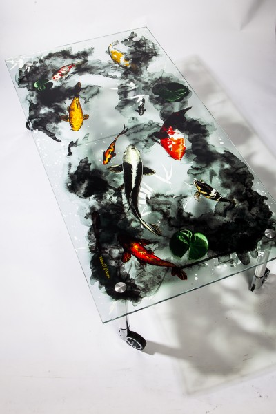 Clear inks can be used to add texture and durability to a wide-format graphic, as with this tempered glass coffee table.