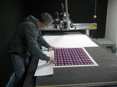 The shop's services include wide-format printing of display cards, banners and other graphics.