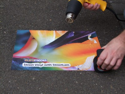 A large-format digital inkjet printer can create many specialty products, including outdoor street graphics.