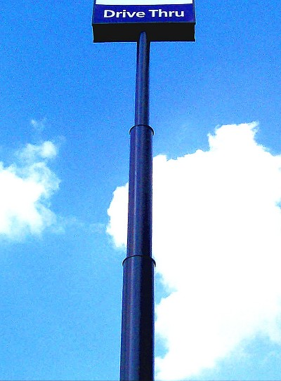 Many free-standing 'high-rise' sign structures near major highways are supported by single poles with a telescoping configuration.