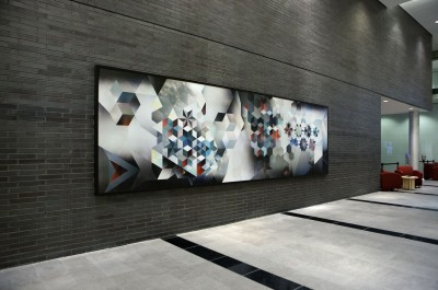 This 6 x 1.8-m (20 x 6-ft) mural for Quebecor comprises seven phased 1.2 x 1.8-m (4 x 6-ft.) lenticular tiles, mounted on a 3-mm (0.12-in.) aluminum composite backing and braced with an aluminum frame. Photo courtesy Softmotion