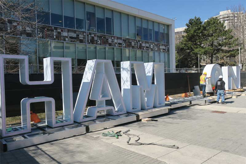 The new sign's aluminum letters are held in place by stainless steel bolts and an HDPE base.