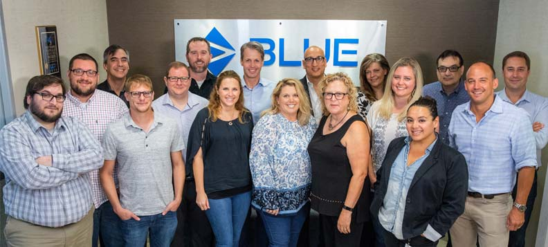 Udo Panenka, president of Esko, Ali Moosani, president of Blue Software, and Heidi Larsen, vice-president brand integration leader with Esko (centre), meet with employees at the Blue headquarters in Chicago.