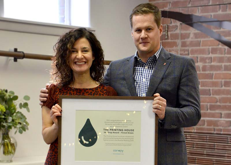 Laura Repas (Canopy) awards Andrew O'Born, vice-president of business development with The Printing House, with Canopy's 2018 Blueline Ranking Award.