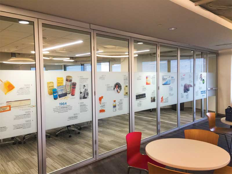 Wall and window graphics are often used to communicate a company or organization's history and story.