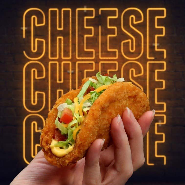 Taco Bell is promoting its new nacho-cheese naked chicken chalupa via a cheese-dispensing billboard in Toronto.