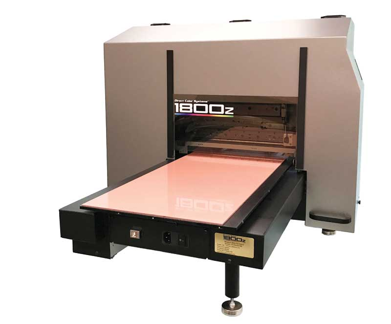 Many small-format ultraviolet (UV) light-emitting diode (LED) printer options can fit within a small footprint or area within a shop. This model, complete with a 305 by 610 mm (12 by 24 in.) print area, can be housed on a 0.6 by 1.2 m (2 by 4 ft) work bench.