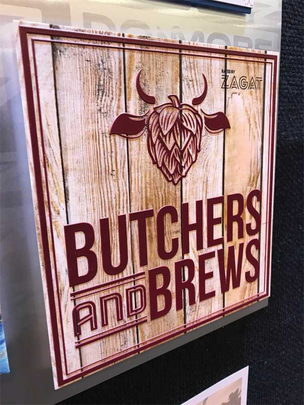 The wood grain background on this Butchers and Brews sign was digitally printed onto generic aluminum sheet stock.