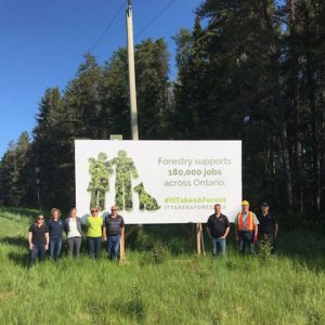 A new billboard is unveiled in Dryden, Ont., for the 'It Takes a Forest' initiative.