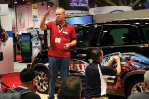Matt Richart and Dallas Fowler, co-founders of Digital EFX Wraps, provide expo attendees with pointers for successfully installing a vehicle wrap.