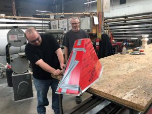 Wilson's Draftsman Eric Granholm, and metal fabricator Terry Companion, work through some production challenges.