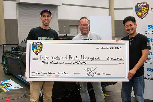 Keiichi Hasegawa (pictured right) and teammate Blake Madsen (pictured left) of Remix Wraps, were first-place winners in the Professional Decal Application Alliance (PDAA) Pro Team Relay at Printing United.