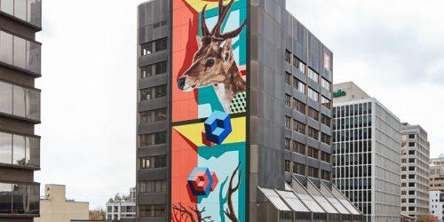 Street artist Jerry Rugg (birdO) has unveiled a 10-storey mural in Toronto.