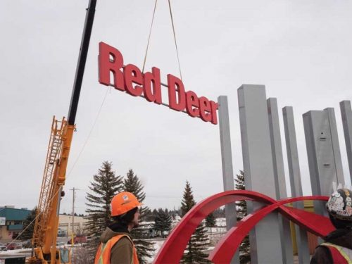 A crane was  used to install the 'Red Deer' letters onto the gateway signage display.