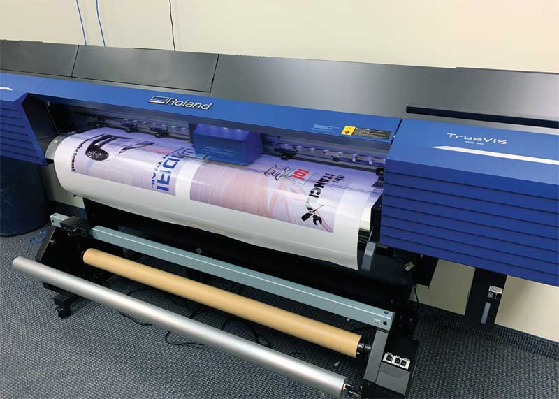 Tyler Lygas decided to buy a Roland wide-format printer/cutter to expand his offerings.