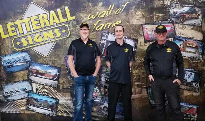 Left to right: Cory Byrnes, Rob Merkel, and Rollin Penner of Letterall Signs Inc.