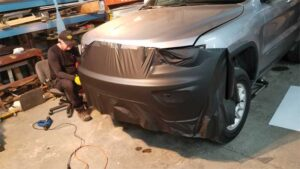 The first step was wrapping the bumper. The team used 3M 2080 film for a better fit around the curves and to achieve a sleek appearance.